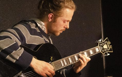 Free Time guitarist Troy Downey tunes his guitar before the show.