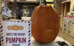 Students could guess the weight of a pumpkin to win a prize.