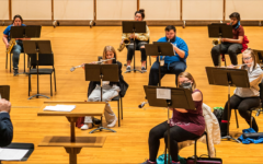 Professor Cory Near directs the Luther College Varsity band in a rehearsal. Members who do not play are masked-up as a COVID-19 safety precaution. Photo courtesy of Photo Bureau