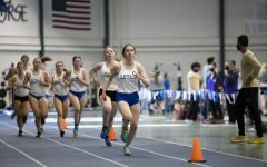 Gabrielle Janssen ('24) leads a pack of runners during Luther's Track and Field triangular against Loras and Coe.