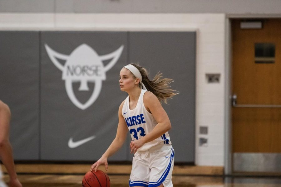 Kristen Elliot ('22) dribbles the ball during a home game against Dubuque University on February 13.