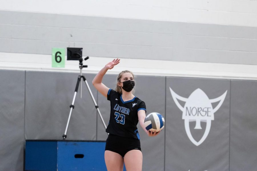 Defensive specialist Greta Stauffacher ('23) serves during Luther's match on March 3 against Loras.