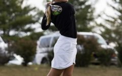 Alayna Eichstadt ('23) hits a shot at the Norse Classic in September 2020.