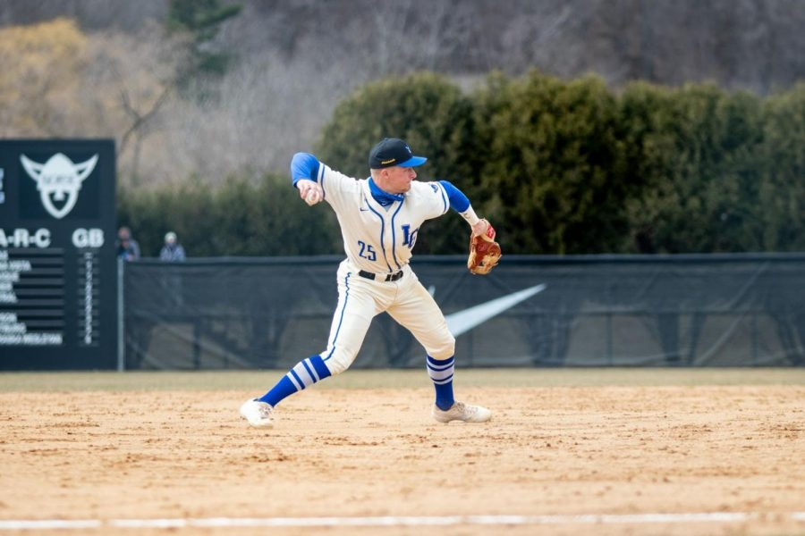 Kelby Johnson ('21) throws to first base during a game against Hamline University on March 21.