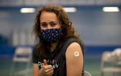 Brooke Stanga ('22) poses after receiving her first COVID-19 vaccination at the on-campus Luther vaccination clinic.