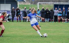 Megan Munger ('23) passes the ball during a game against Coe College earlier this season.