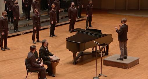 David Gorman ('21) conducts the Norskkor choir. Jackson Geadelmann ('23) | Chips