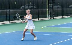 Devon Bourget ('21) hits a forehand during the championship match against Wartburg. (Photo courtesy of Antony Hamer for Luther College Photo Bureau)