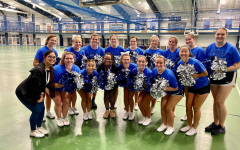Dean of Student Engagement Ashley Benson poses with the Luther College cheerleading team after joining in on one of their practices. Photo courtesy of Luther College Cheer.