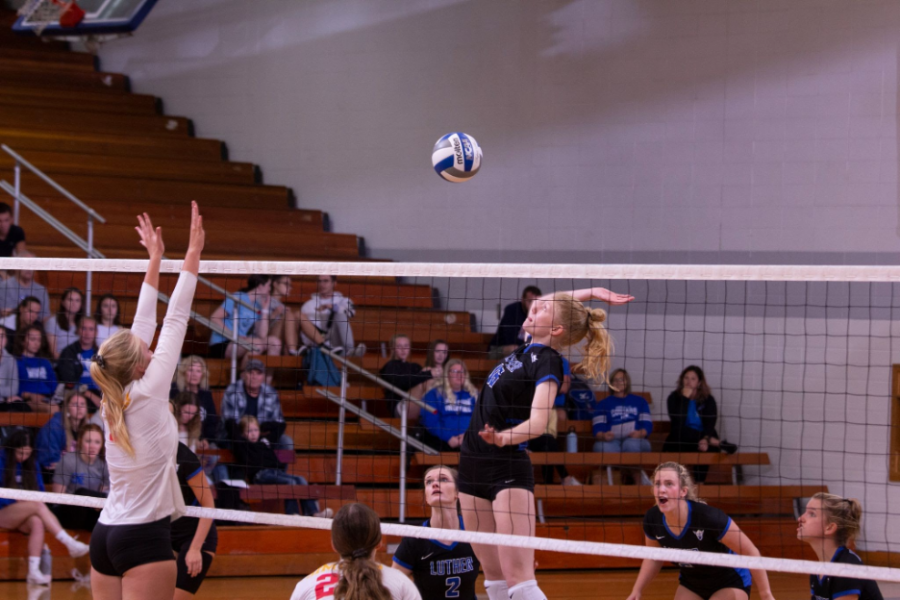 Luther middle blocker Hannah LaBonte ('25) jumps up for a swing during a match against Simpson College on September 21. (Photo courtesy of Luther College Photo Bureau)