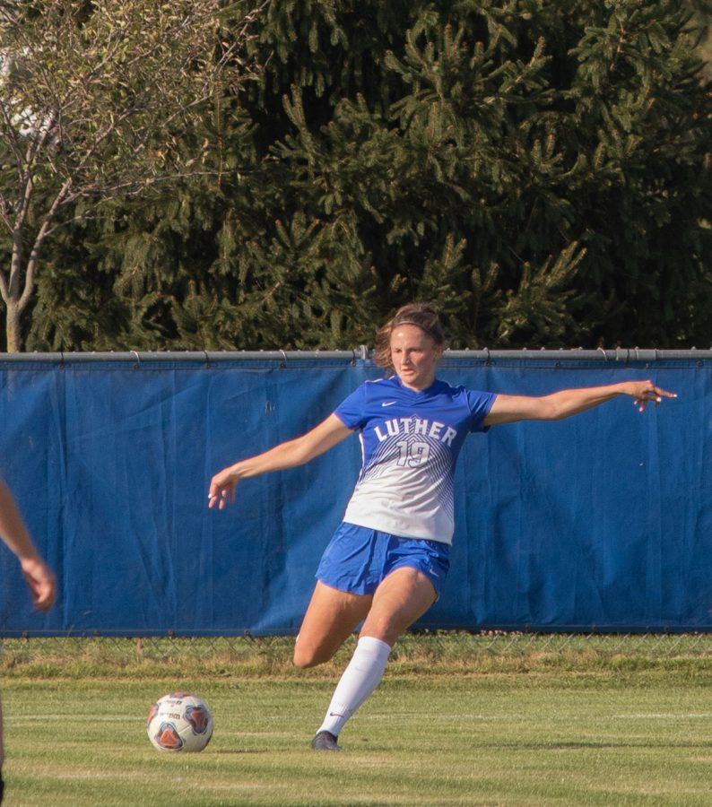 Luther defender Ella Smith ('23) kicks the ball downfield during a game against the UW-La Crosse earlier this season.