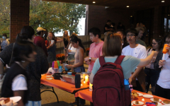 Students lining up for boba and mooncakes under the CFL awning. (Photo by Hallie Johnson 23)