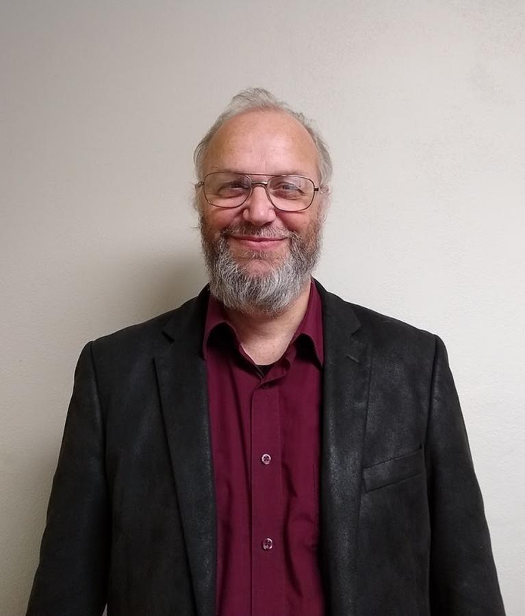 Professor of Religion Gereon Kopf poses for a headshot. Photo courtesy of Professor Gereon Kopf.