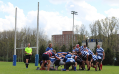 """The current Luther rugby players and the """"Old Boys"""" prep for a scrum during their match on Saturday, October 2. (Photo by Cassandra Hultgren)"""